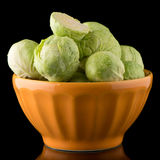 Fresh brussels sprouts. On orange ceramic bowl isolated on white background Royalty Free Stock Photography