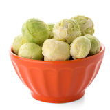 Fresh brussels sprouts. On orange ceramic bowl isolated on white background Stock Photo