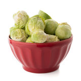 Fresh brussels sprouts. On red ceramic bowl  on white background Royalty Free Stock Photos