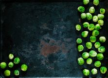Fresh brussels sprouts  on vintage rusty metal background, vegetables for healthy cooking, flat lay,copy space, closeup. Diet, pure food or the concept of Stock Image