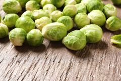 Fresh Brussels sprouts on wooden table, closeup. Space for text stock image