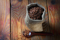 Fresh buckwheat  on wooden background Royalty Free Stock Images