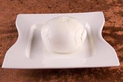 Fresh buffalo mozzarella. On a white plate stock photos