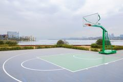 Fresh built basketball court at lakeside in cloudy winter afternoon. Fresh built basketball court at the lakeside in cloudy winter afternoon,Tianfu New Area royalty free stock images