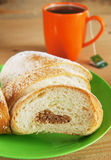 Fresh bun and cup of black tea for lounch Royalty Free Stock Photo