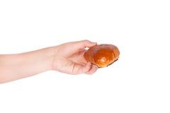 Fresh bun in his hand Stock Photos