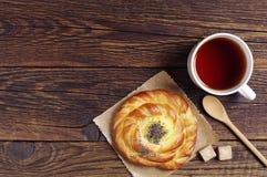 Fresh bun and tea Stock Photos