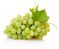 Fresh bunch of green grapes with leaves isolated on white background. Fresh bunch of green grapes with leaves isolated on a white background stock photos