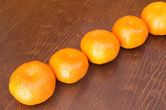 Fresh bunch of mandarines. In a wooden background Royalty Free Stock Photography