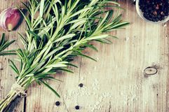 Fresh bunch of rosemary on wooden table. Stock Image