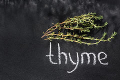 Fresh bunch of thyme on a chalky black board Stock Photo