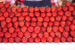 Fresh bunch of vivid strawberries in a market Stock Image