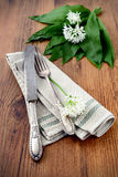 Fresh bunch of wild garlic on table with antique silverware Stock Photos