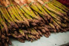 Fresh bundles of organic asparagus Stock Images