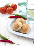 Fresh buns. Beef and chili buns with sesame seeds on an old enamel plate. Rustic country style stock photography