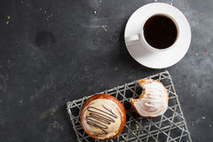 Fresh buns and cup of coffee Stock Images