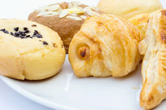The fresh buns isolated on white plates Stock Photos