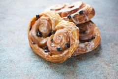 Fresh buns with raisins and icing on old rusty background.  Royalty Free Stock Images