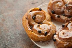 Fresh buns with raisins and icing on old rusty background. with copy space.  Stock Images