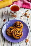 Fresh buns with raisins and nuts, a cup of tea. Vertical Stock Image
