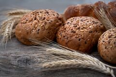 Fresh Buns With Whole Grains On A Wooden Table Stock Image