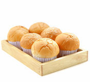 Fresh buns on a wooden tray isolated Royalty Free Stock Photos