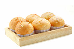 Fresh buns on a wooden tray isolated Stock Photos