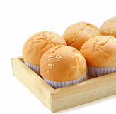 Fresh buns on a wooden tray isolated Stock Image