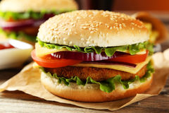 Fresh burger on a brown wooden background Royalty Free Stock Photography