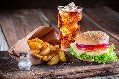 Fresh burger with cold drink and fried egg Royalty Free Stock Photography