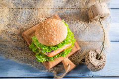 Fresh burger with fish and vegetables Royalty Free Stock Image
