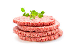 Fresh Burger Patties. Raw on a white underground Stock Images