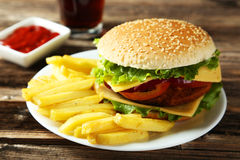 Fresh burger on plate on wooden background Stock Photos