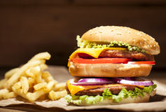 Fresh burger on wooden background Stock Images