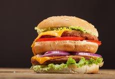 Fresh burger on wooden background Royalty Free Stock Photo