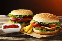 Fresh burgers on wooden background Stock Photos