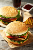 Fresh burgers on wooden background Stock Photo