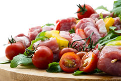 Fresh butcher cut meat assortment garnished close up selective f Royalty Free Stock Image