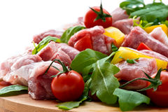 Fresh butcher cut meat assortment garnished close up selective f Royalty Free Stock Photos