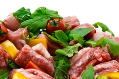 Fresh butcher cut and tomatoes meat assortment garnished Stock Image