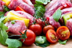 Fresh butcher cut and tomatoes meat assortment garnished Stock Photo