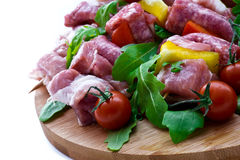 Fresh butcher cut and tomatoes meat assortment garnished Stock Photos