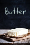 Fresh butter and blackboard Stock Image