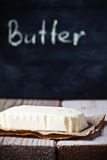 Fresh butter and blackboard Royalty Free Stock Photography