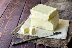 Fresh butter block. Rustic scene. Fresh butter. Block shape. Rustic background stock photo