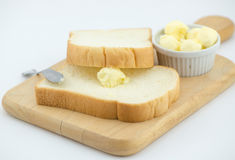 Fresh butter on bread isolated Stock Images