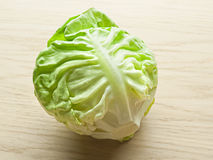 Fresh butter lettuce on wooden board royalty free stock photography