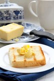 Fresh butter on toast Stock Images