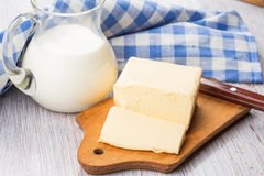 Fresh butter on wooden board. Stock Images