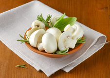 Fresh button mushrooms and culinary herbs Royalty Free Stock Photo